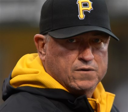 bucs 22 Pirates manager Clint Hurdle waiting for the rain to stop some day in Baltimore.