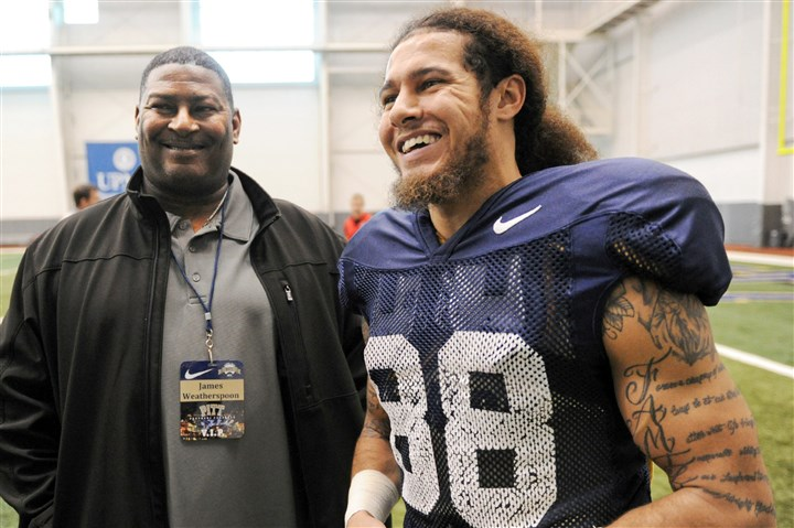 "pittfb22 Pitt's Kevin Weatherspoon with dad, James, during a ""father's day"" event during spring practice Friday on the South Side."