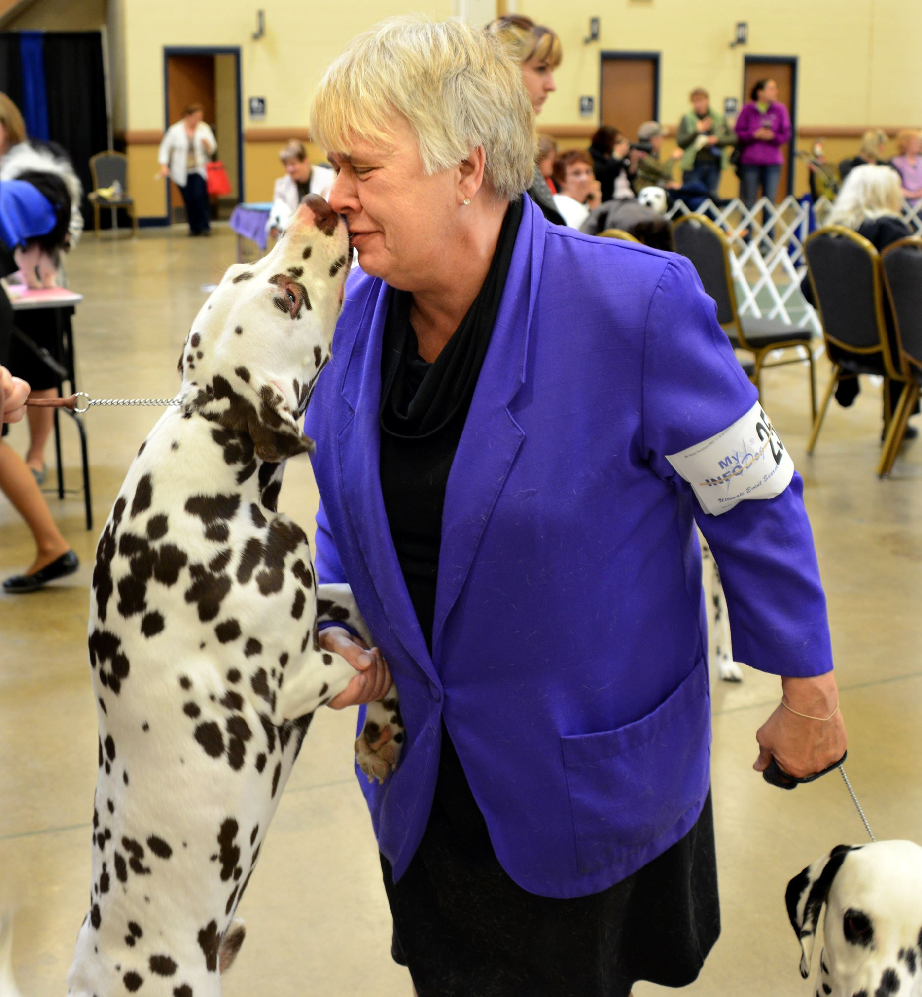 201445RARlocaldog3-11 Cindy Riggans of Canton, Ohio, gets kisses from her former puppy Lindsey as she waits to show her dog George during the Western Pennsylvania Kennel Association dog show at the Monroeville Convention Center. Ms. Riggans bred Lindsey and used to show him.
