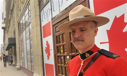 20140407lrcanadalocal03 Royal Canadian Mounted Police Constable Eric Hymander stands outside the Pop-Up Canada storefront on Smithfield Street on Monday. People are invited to take selfies of themselves with the mounties visiting the store then send them in to the show's website.