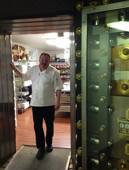 20140407deliwesvault Wesley Ross stands in the entrance of the kitchen – a converted antique bank vault inside The Bank Tower – at Carnegie Delicatessan & Catering, Downtown.