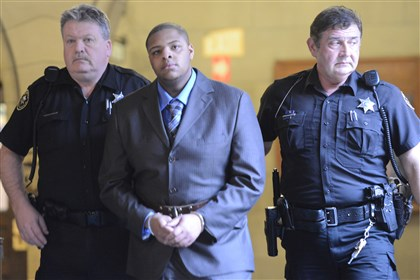 20140407bdIsiahSmith2 Isiah Smith, 23, of Lincoln-Lemington, center, was sentenced Wednesday to five to 15 years in prison in the fatal shooting of a Brookline man outside the Original Hot Dog Shop in Oakland.