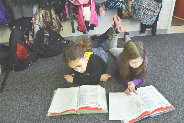 Portersville 1 Fourth-graders Jaelyn Sanchez and Maddie Ihlenfeld study in their math class at Portersville Christian School.