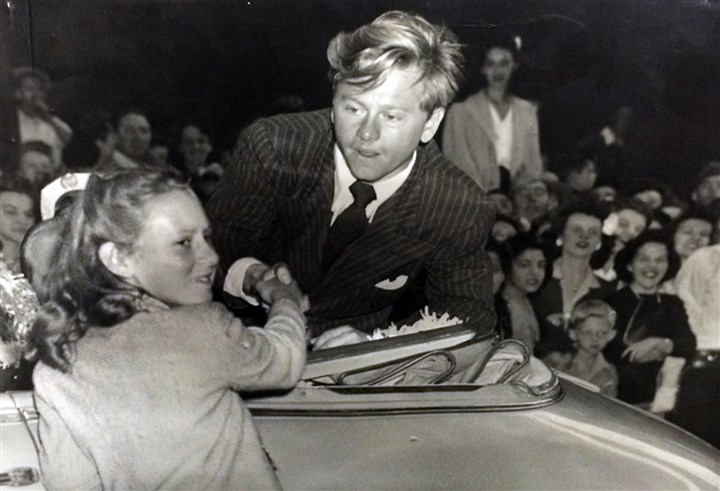 Mickeyone408 When Mickey Rooney came to Pittsburgh for a September 12, 1943, Victory Parade he shook hands with a young girl identitied as Ruth Greb, daughter of a Pittsburgh Police officer. The photo was taken in 1943 by the Sun Telegraph.