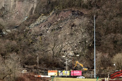 20140408dsMudslideLocal04 A landslide across the railroad tracks above West Carson Street led to a temporary shut down of the Duquesne Incline and the rail line Tuesday.
