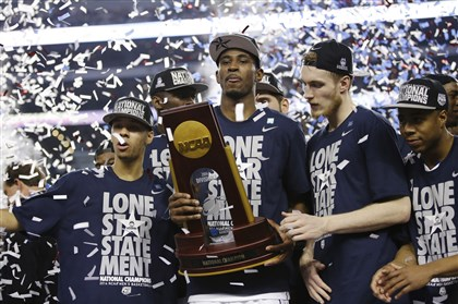 NCAA Kentucky UConn Final Four Basketball From left, Connecticut guard Shabazz Napier, forward, forward DeAndre Daniels, and guard Niels Giffey celebrate after their team beat Kentucky 60-54 Monday in the NCAA championship game.