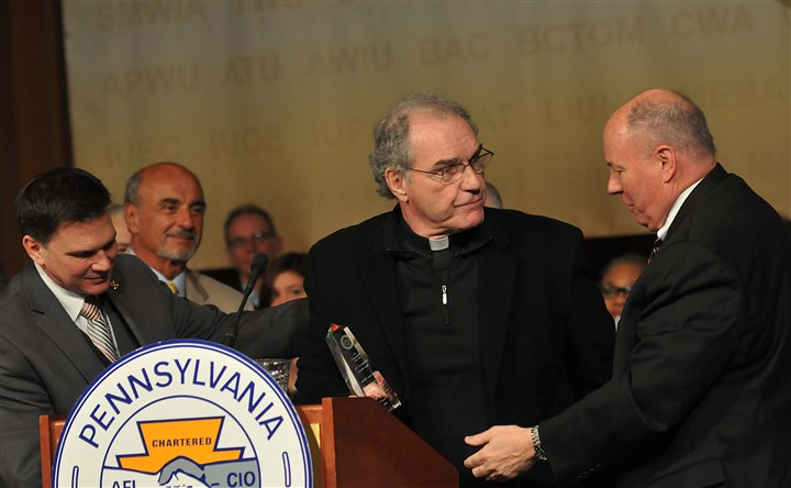 20140408lromalleylocal03-2 The Rev. Jack O'Malley, center, stands between Pennsylvania AFL-CIO President Richard Bloomingdale, right, and Secretary-Treasurer Frank Snyder after accepting the AFL-CIO's Citizen of the Year Award.