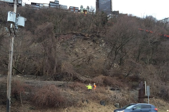 20140408dsLandslide1.jpg A landslide across the railroad tracks above West Carson Street led to a temporary shut down of the Duquesne Incline and the rail line.