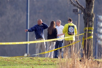 Stabbings 2 People waiting for news outside of Franklin Regional Middle School.