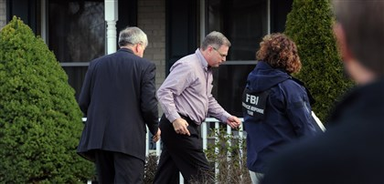 20140409JHLocalStabbing06 Harold Hribal, father of the stabbing suspect, center, and FBI agents enter Mr. Hribal's house in Murrysville.