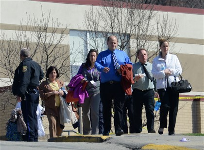 Franklin Regional High School 5 Teachers and staff leave Franklin Regional High School Wednesday morning following the stabbing incident.
