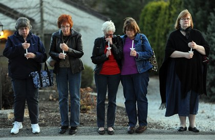 20140409MWHvigilLocal01-1 From left, Dorothy DiEugenio of Murrysville, Ruth Greer of Monroeville, Barb Stuffer of Penn Township, Joan Smeltzer of Latrobe and Susan Fox of Churchill stand across the street from Franklin Regional High School as churchgoers and community members hold a candlelight vigil and prayer service Wednesday.