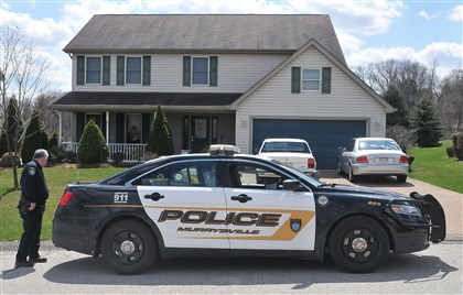 20140409lrstabbingsuspect06 A Murrysville police car sits in front of the Sunflower Court home of the Hribal family on Wednesday.