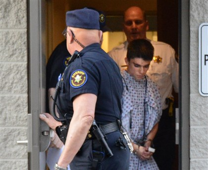 Alex Hribal Suspect Alex Hribal is escorted from the magistrate's office after his arraignment Wednesday.