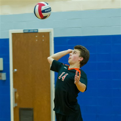 Latrobe.1.jpg Greater Latrobe's Zane Harshell, a 5-foot-10 senior libero, serves up a shot during the Derry Area tournament.