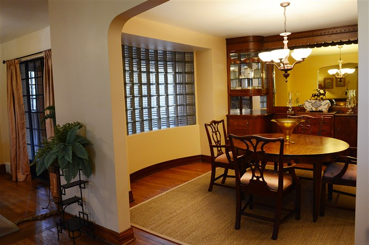 20140408jrHomesMag1 The dining room has a wall of built-in mahogany cabinets.