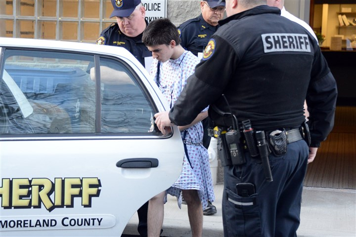 201449RARlocalsuspect2 Suspect Alex Hribal is escorted by sheriff deputies after his arraignment in the stabbing of students at Franklin Regional High School.