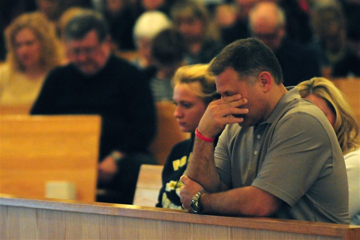 Nick Dorsch Nick Dorsch, father of two Franklin Regional students, wipes away tears during a prayer and vigil service for victims of the Franklin Regional High School stabbings at the Mother of Sorrows Catholic Church in Murrysville.