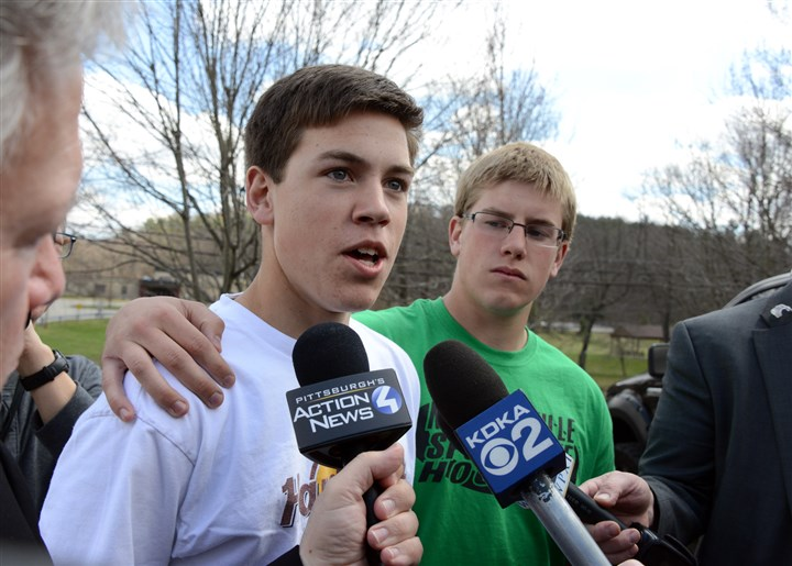 201449RARlocalstab-7 Connor Wolff, 18, right, puts his arm around his friend Ian Griffith, 18, as Mr. Griffith talks to reporters outside of the Murrysville police station. Mr. Griffith, along with school officials, reportedly helped to tackle the stabbing suspect. Mr. Griffith and Mr. Wolff are both seniors at Franklin Regional High School.
