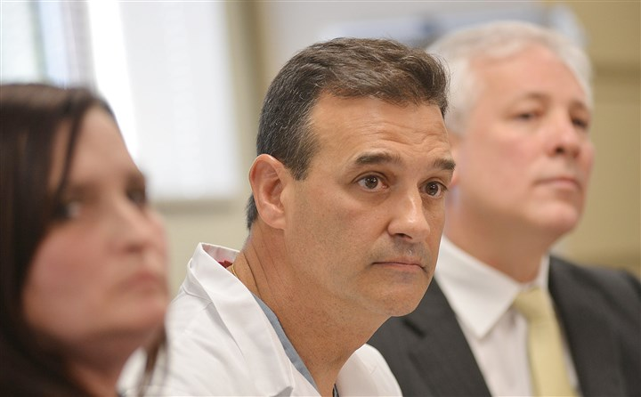 LR07 Knife Attack in Murrysville Outside Pittsburgh  Amber Egyud, left, chief nursing officer, and Mark Rubino, center, chief medical officer at Forbes Regional Hospital, and Reese Jackson, hospital CEO, listen to a question Wednesday during a news briefing about the victims brought to the hospital.