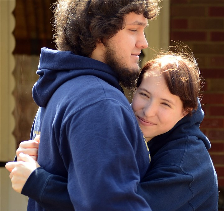 rad04 Knife Attack in Murrysville Outside Pittsburgh  Franklin Regional High School junior Gracey Evans hugs boyfriend Jacob Fritch at her home Wednesday afternoon. She applied pressure to a fellow student's stab wound until he could be treated.