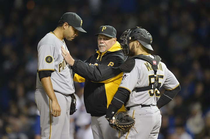 pirates cubs Pirates pitching coach Ray Searage and catcher Russell Martin, right, talk with relief pitcher Jeanmar Gomez during the sixth inning against the Cubs at Wrigley Field.