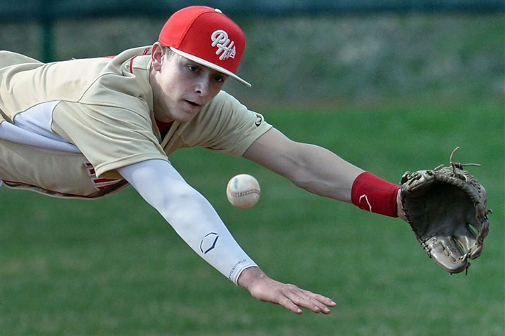 pennhills0410 Penn Hills' Zac Crosmun reaches for a ground ball hit by Shaler Wednesday afternoon.
