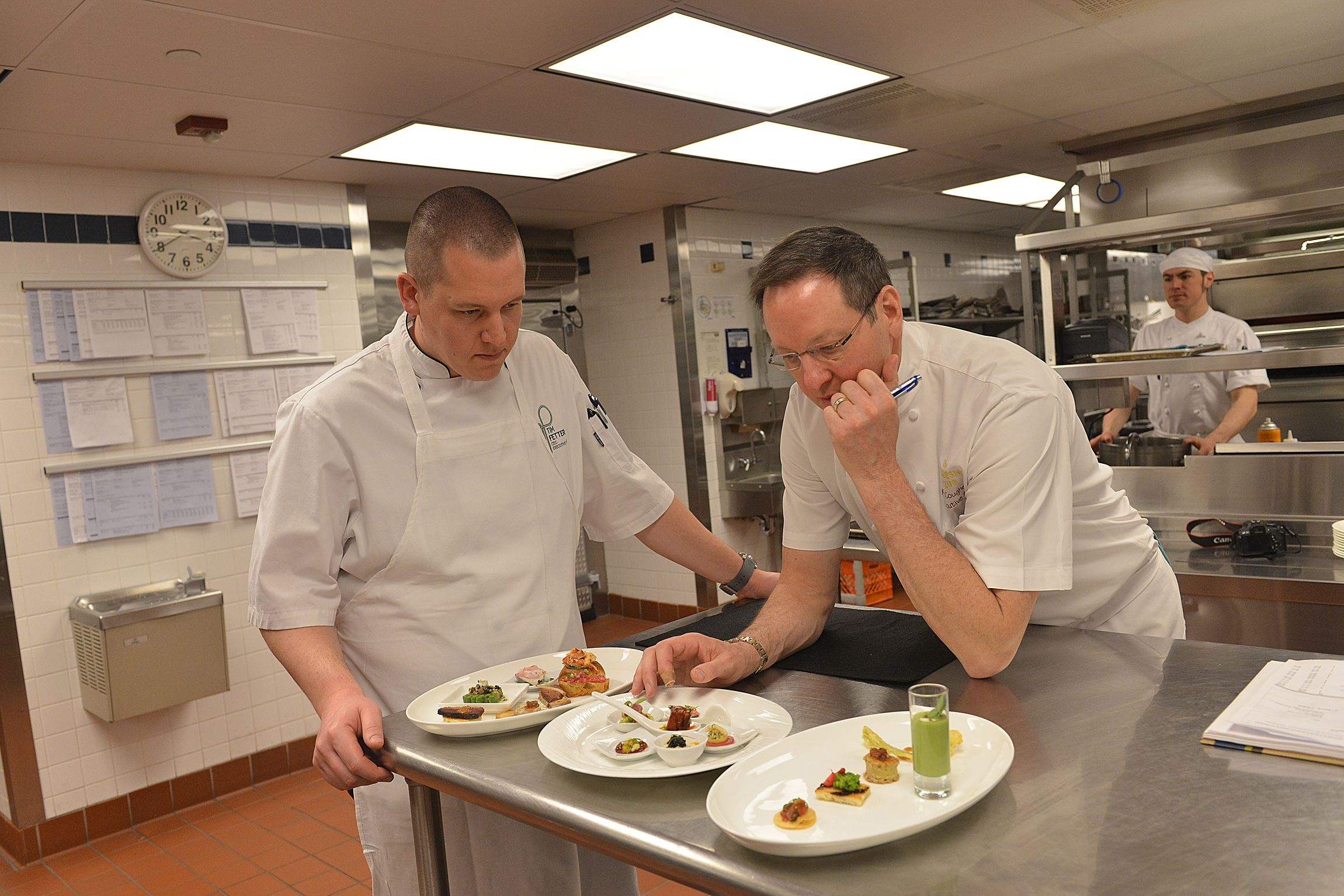 20140408lrkellerfood16 Chefs Tim Fetter and Keith Coughenour review food choices during a planning session at the Duquesne Club for a dinner honoring Thomas Keller.