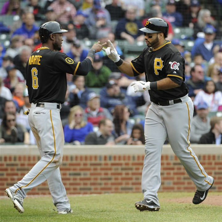 20140410Pirates Cubs Baseball.JPEG-.36 Pedro Alvarez, right, is greeted by Starling Marte after hitting a three-run home run against the Chicago Cubs during the seventh inning.