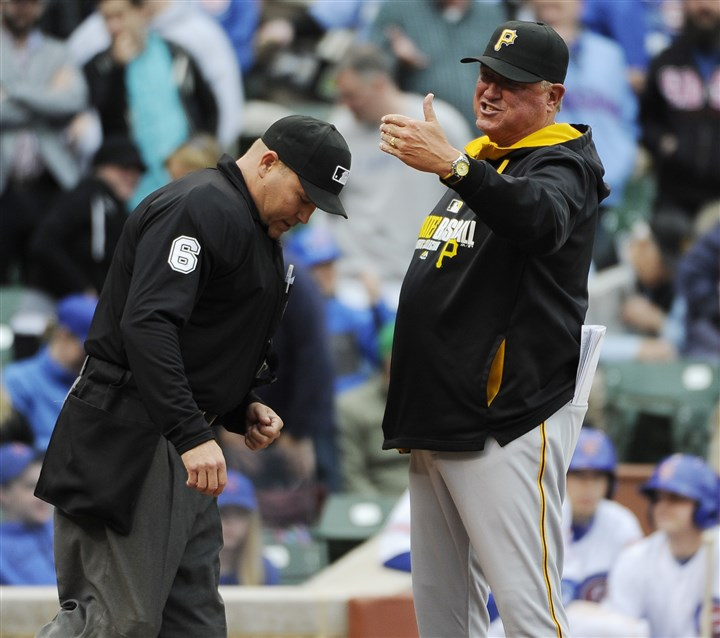 Pirates Cubs Baseball.JPEG-.6-3 Pirates manager Clint Hurdle discusses a call with umpire Mark Carlson in Chicago.