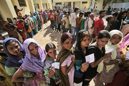 Voters in Jammu, India Indians stand in line to cast their votes Thursday outside a polling station during parliamentary elections in Jammu, India. The multiphase voting across the country runs until May 12. The results for the 543-seat lower house of Parliament will be announced May 16.