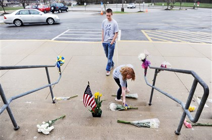 Katia Barwinske and Andrew Lehn Juniors Katia Barwinske, 16, and Andrew Lehn, 16, lay flowers on the steps of Franklin Regional High School on Friday, two days after more than 20 people were injured there in a mass stabbing.