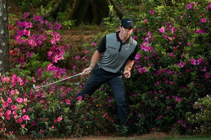 Rory McIlroy Rory McIlroy of Northern Ireland walks out of the azalea bushes behind the 13th green after hitting a shot during the second round of the 2014 Masters Tournament at Augusta National Golf Club on April 11, 2014 in Augusta, Georgia.