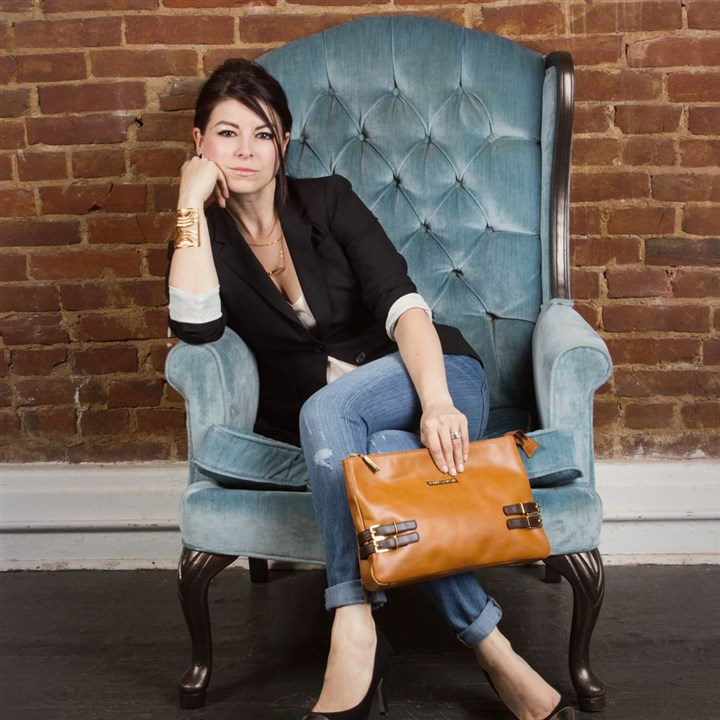 stylebooksnapshot0413 Pittsburgh-based designer Sandra Reiman wears jewelry and holds a handbag from her collection, Sandra Cadavid.