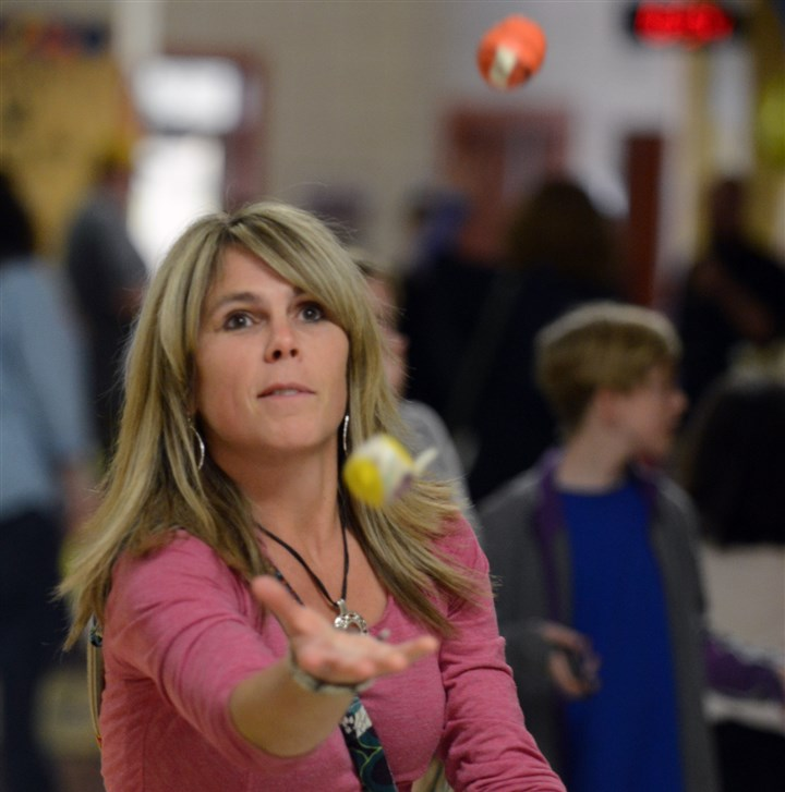 20140410bwJuggleNorth02 Jodi Renner of Sewickley tries her hand at juggling three balls before the 11th annual Family Juggling Night and Juggling Competition at the Quaker Valley Middle School.