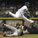 Brewers shortstop Jean Segura turns the double play as Pedro Alvarez slides into second base in the top of the second inning earlier this season at Miller Park in Milwaukee, Wisc. The Pirates have slid to six games beneath the Brewers in the National League Central Standings.