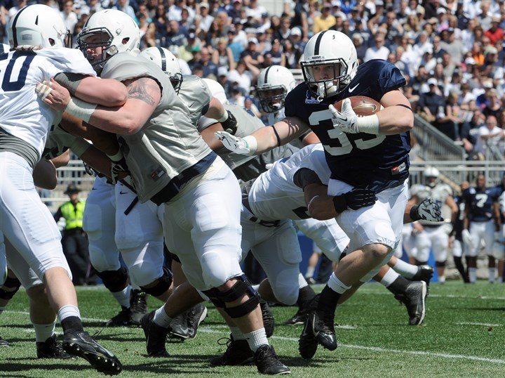 Cole Chiappialle Blue-White scrimmage  Cole Chiappialle looks for an opening in Saturday's Blue-White scrimmage in University Park, Pa. He rushed for 63 yards on nine carries and scored two touchdowns.