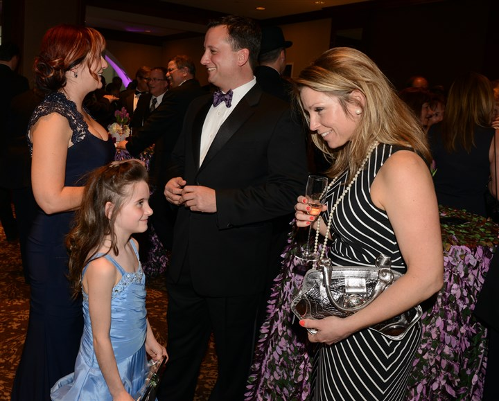 20140412bwRainbowSeen06-6 Colleen Czyzewski and daughter Abby, 7, left, talk with John and Tara Tramontina.