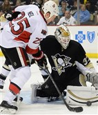 Penguins goalie Jeff Zatkoff makes a save on the Senators' Chris Neil during a game earlier this year at Consol Energy Center.