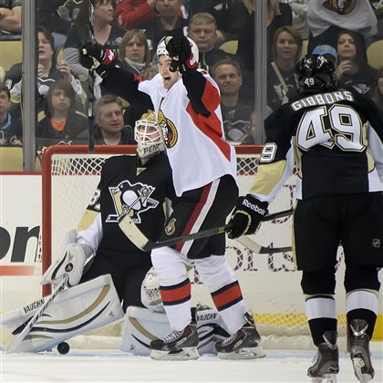 20140413pdPenguinsSports02 The Senators' Mark Stone celebrates a first period goal in front of Penguins' goalie Jeff Zatkoff at Consol Energy Center.