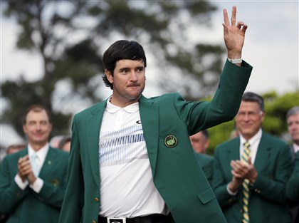 bubba0414a Bubba Watson waves after being presented with his second green jacket after winning the Masters Sunday in Augusta, Ga.