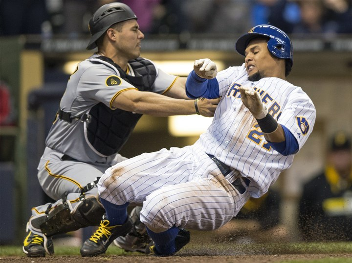 Pirates Brewers Baseball The Brewers' Carlos Gomez is tagged out at home by the Pirates' Tony Sanchez during the seventh inning.