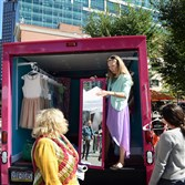 Vintage Valet fashion truck owner Marissa Zimmerman assists shoppers during a fashion pop-up event in Market Square during Pittsburgh Fashion Week.