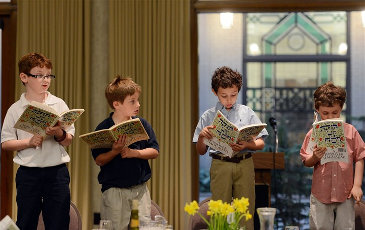"20140414jrSederLocal7-3 From left, Zachary, 8, and Joshua Silnutzer, 6, and Adam, 9, and Michael Bisno, 5, read the ""Four Questions,"" which ask why Passover is a special night."