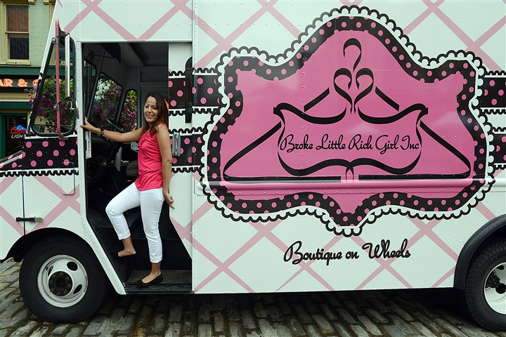Broke Little Rich Girl fashion truck Samantha Lugo with her mobile boutique, Broke Little Rich Girl.