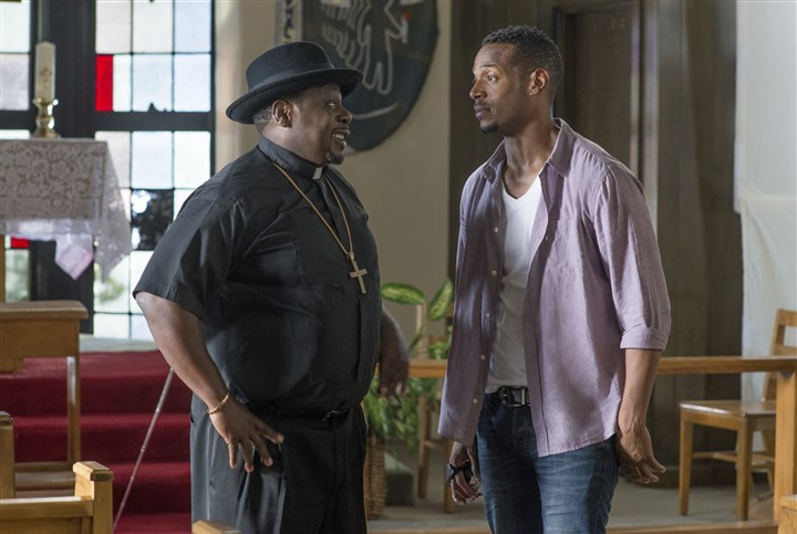 "20140418Haunted2-1 Cedric the Entertainer as Father Williams and Marlon Wayans as Malcolm in ""A Haunted House 2"""