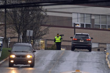 Franklin Regional High School Traffic is directed early this morning as students and parents arrive at Franklin Regional High School.