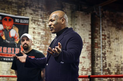 tyson0418a Mike Tyson speaks to a group of Wounded Warriors Tuesday at the Wolfpack Boxing Club in Carnegie, Pa.