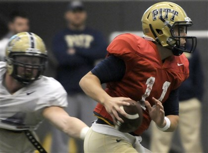 pittfb2 Pitt quarterback Trey Anderson eludes a tackler during a drill at the final spring practice for the Panthers.