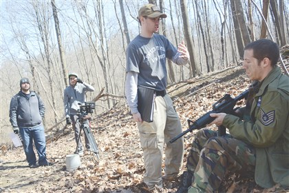 Scott film 1 Ryan Rust, center, a filmmaker from Carnegie, gives instruction to actor Don Antonelli, 19, of Pittsburgh while filming in the Kane Woods Nature Area.